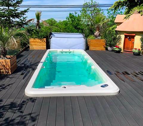Spa Studio - venkovní vířivé bazény Canadian Spa International® - sportovní plavecké swim spa Octopus s protiproudem pro nekonečné plavání a s masážními pozicemi